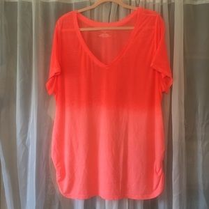 Bright orange V-neck tee with side ruching.